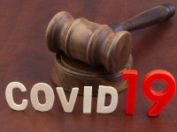 Wooden judge gavel with letters covid19. Concept of quarantine and law against covid-19.