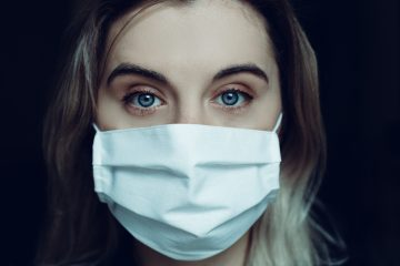 Young woman wearing a medical mask